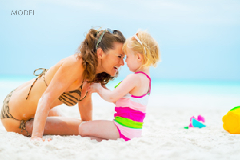 Mother Playing with Daughter on the Beach